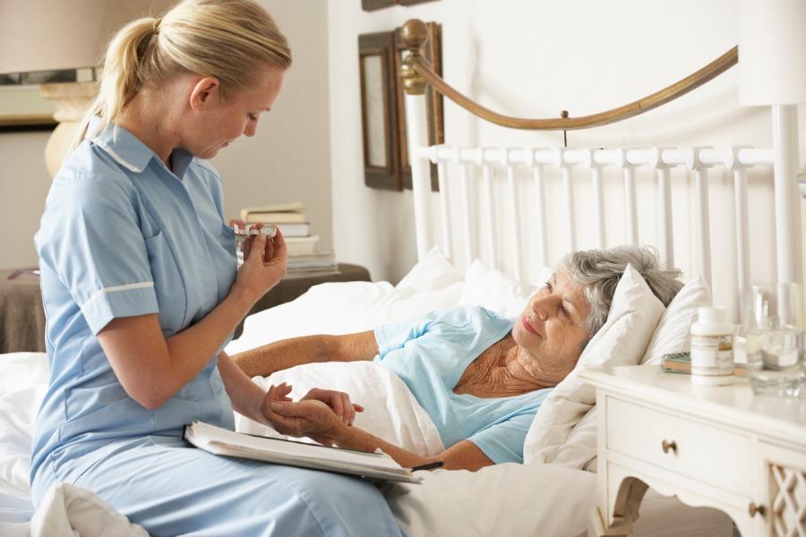 nurse-assisting-hospice-patient